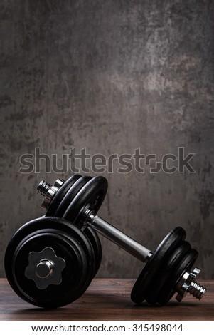 Heavy black dumbbells for workout