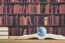 Heavy book and globe