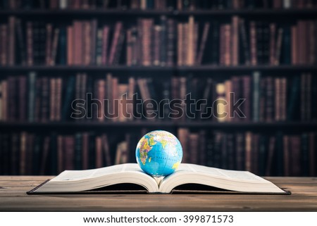 Heavy book and globe