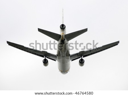 Heavy cargo jet airplane taking off rear view - stock photo
