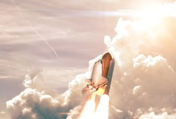 Heavy Carrier Rocket Launch into blue sky. Space mission. Elements of this image furnished by NASA.