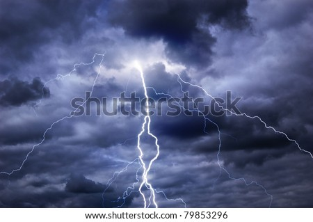 Heavy clouds bringing thunder, lightnings and storm.