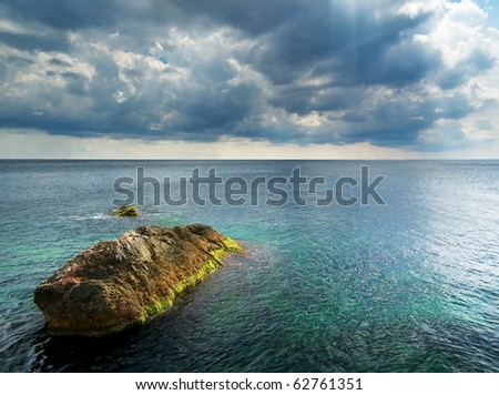 Heavy clouds on sea. Nature composition.