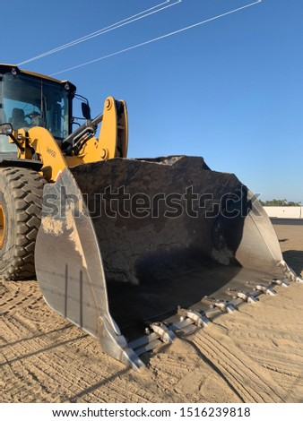 Heavy construction equipment for excavation and dirt moving