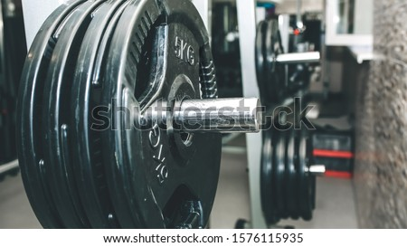 Heavy dumbbells lying in the raw in the gym. Fitness sport motivation. Happy healthy lifestyle living. Exercises with bars weights.
