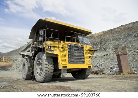 Heavy dump truck driving through the opencast