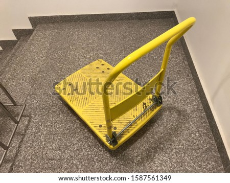 Heavy Duty Folding platform trolley truck with 150 Kg Capacity and Painted with Yellow color Enamel paint for Bringing goods from Vehicle to Hotel Kitchen Area