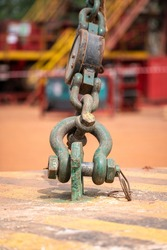 Heavy duty lifting shackle and bolt part that using as anchor weight counter of the drilling rig's derrick. Industrial equipment object, Partial focus on the shackle part.
