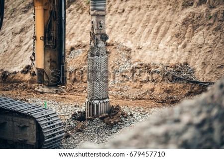 heavy duty machinery used for drilling holes in the ground on construction site. Highway building details with rotary drilling machine