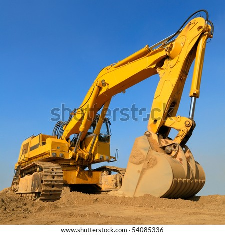 Heavy earth mover on a sunny day with the blue sky in the background