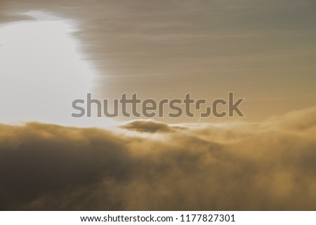 heavy fog,The thick fog float over the high mountains in the morning with the sun shining in the morning. #1177827301