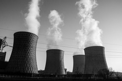 Heavy industrial air pollution from smokestacks. Factory chimney blowing pollution in environment. Black and white. Toxic smoke from thermal power plant in industrial area. Industrial landscape