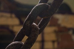 Heavy industrial chain links in tension.