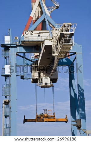 Heavy industrial crane used to load and unload large cargo ships at a port