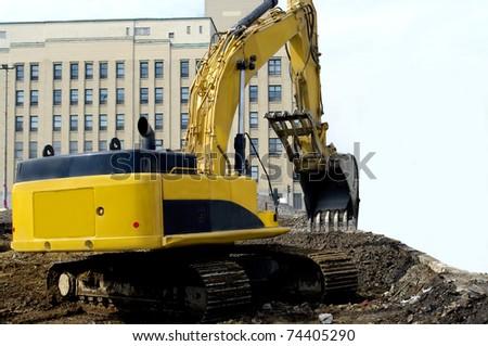 heavy industrial machinery in excavation work site construction in progress.