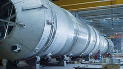 Heavy Industry Manufacturing Facility / Factory where Large Diameter Pipe is Being Assembled. Modern Industrial Manufacturing Technology to Design and Construct Oil, Gas and Fuels Transport Pipeline.