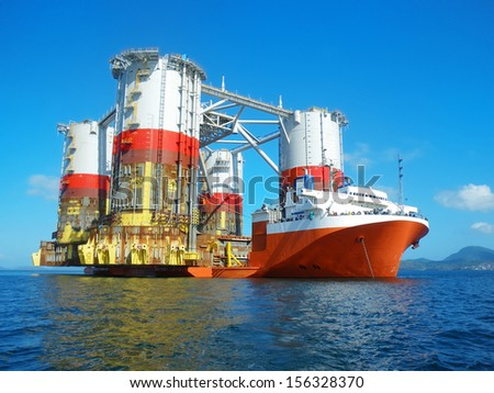 Heavy lift cargo ship transporting an oil rig #156328370