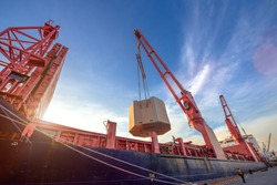 heavy lift cargo unit is on/off-loading discharging loading operation handle by the jumbo heavy crane of the ship to delivery the shipment to destination by sea and land transports