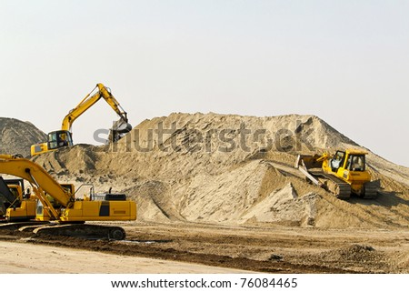 Heavy machinery equipment at road construction site