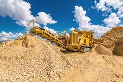 Heavy machinery in a quarry doing work