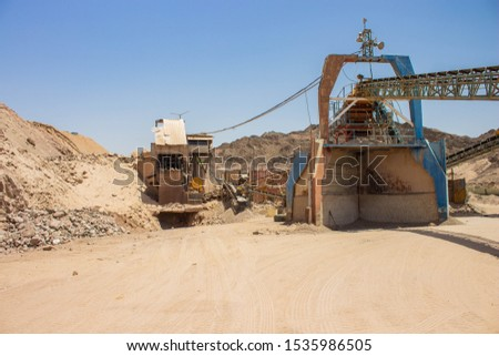 heavy machinery industrial equipment for digging in desert quarry place