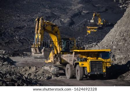 Heavy machinery works in a coal mine