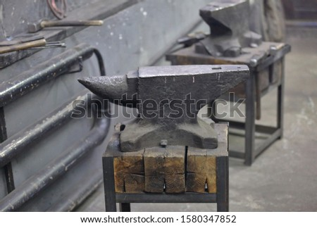 Heavy metal anvil in the forge for forging handmade products #1580347852