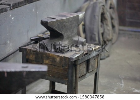 Heavy metal anvil in the forge for forging handmade products #1580347858