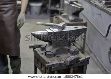 Heavy metal anvil in the forge for forging handmade products #1580347861