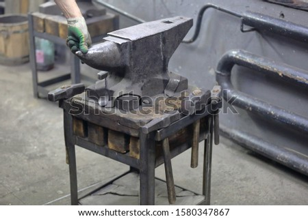 Heavy metal anvil in the forge for forging handmade products #1580347867