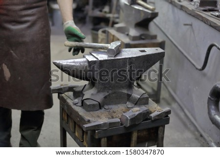 Heavy metal anvil in the forge for forging handmade products #1580347870