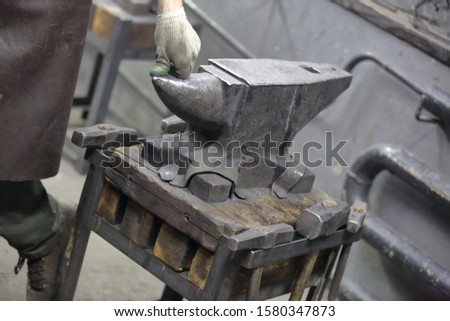 Heavy metal anvil in the forge for forging handmade products #1580347873
