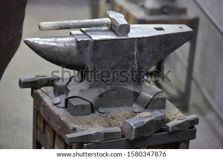 Heavy metal anvil in the forge for forging handmade products #1580347876