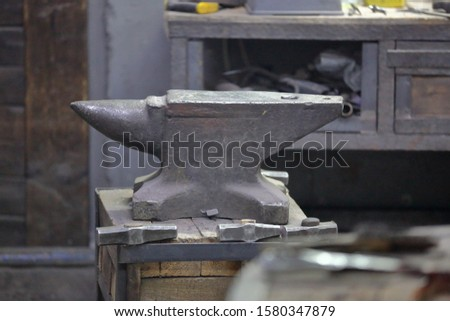 Heavy metal anvil in the forge for forging handmade products #1580347879