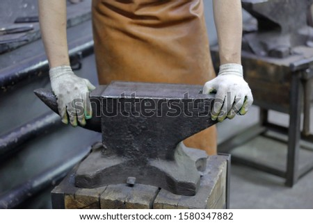 Heavy metal anvil in the forge for forging handmade products #1580347882