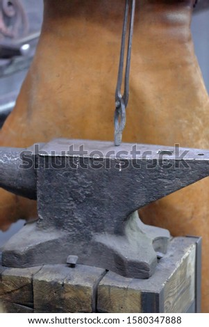 Heavy metal anvil in the forge for forging handmade products #1580347888