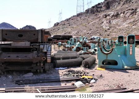 Heavy metal parts and machinery languish under the desert sun