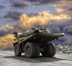 Heavy mining truck driving along the opencast