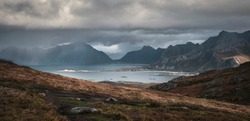 Heavy rain and sun over mountains and sea at Lofoten Islands in autumn Norway