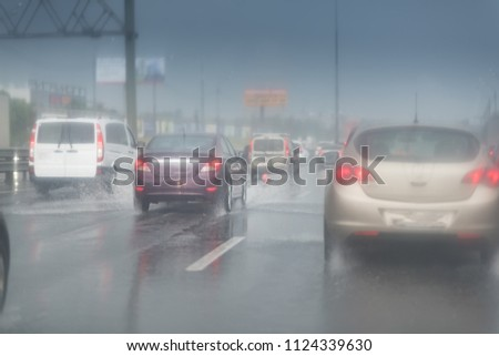 Heavy Rain Highway Traffic. Extreme Road Conditions. Rainy Weather Driving. #1124339630