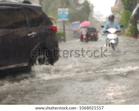 Heavy rains flooded the streets.subject is blurry. #1068021557