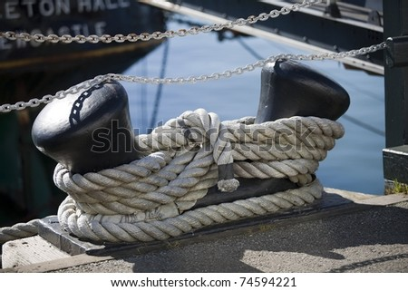 Heavy rope tied to a cleat on a dock stock photo 74594221 for Heavy rope for nautical use