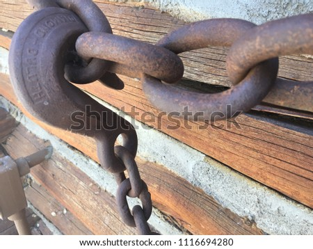 heavy rusted hook and chain...