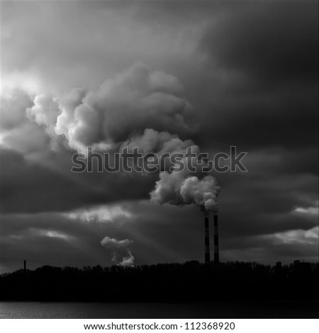 Heavy smoke from industrial chimney polluting the environment