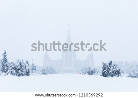 Heavy snowfall in Moscow. Snow-covered roads. Moscow State University and streets during blizzard. Collapse of public services.