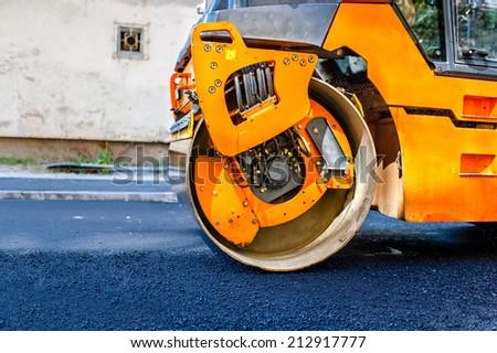 Heavy Tandem Vibration roller compactor at asphalt pavement works for road repairing.