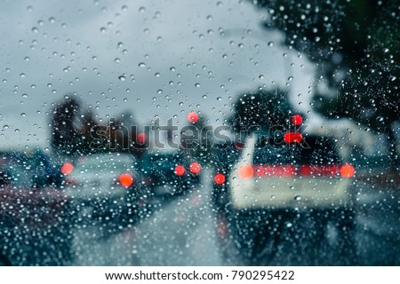 Heavy traffic during a rainy day; raindrops on the window