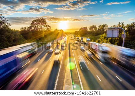 heavy traffic moving at speed on UK motorway in England at sunset Stock photo ©