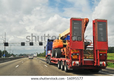 Heavy transport with trailer at the highway #16095577