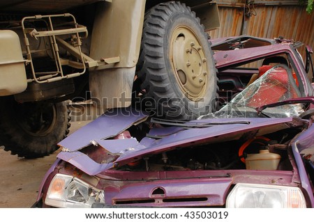 Heavy truck crunches a car. Location Czech republic.